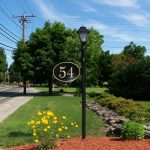 lawn address signs house number beautiful neighborhood green living plants and tress beautiful yellow flower