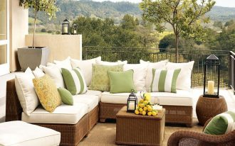 lawn furniture sofas pillows table vase plants