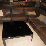 leather distressed brown sectional sofa with black table