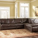 leather sectional sofa in brown color and best sectional sofa for the money with modern rug on sophisticated floor and beige wall