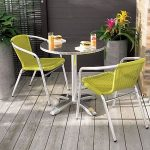 lime green affordable modern outdoor furniture beautiful pink yellow decorative flowers round patio table gray wood floor