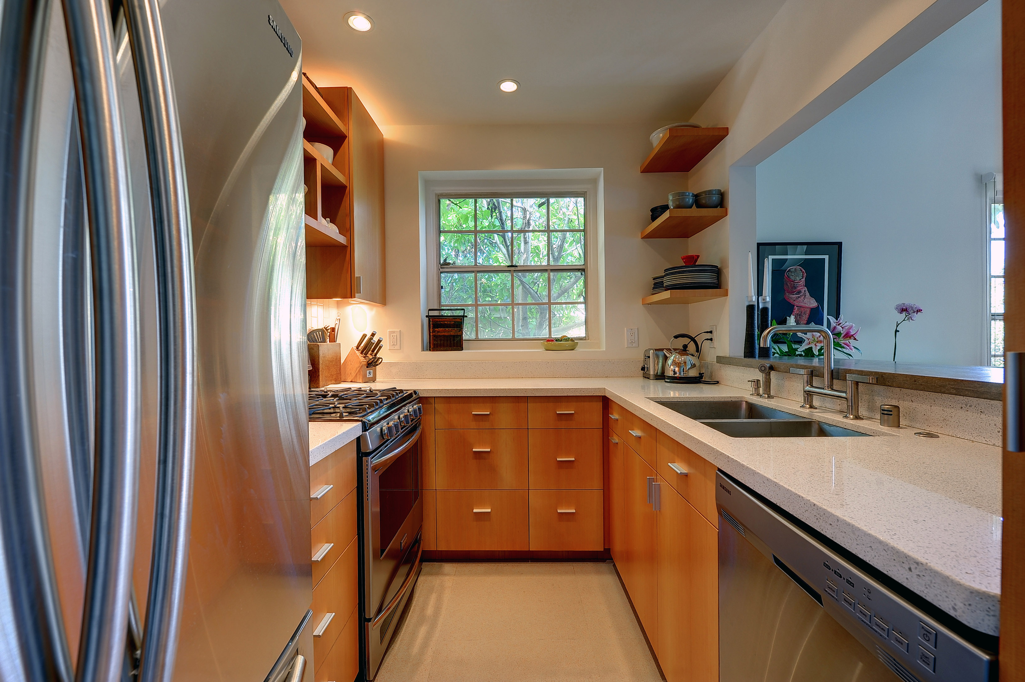 living kitchen small home steel refrigerator wood set square windows double sink shelfs cabinets - Small Homes That Live Large