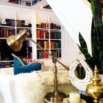 living room small home living bookshelf white sofa blue pillow unique lamp candle