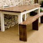 long chair table wood floor stone wall