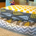lovable gray yellow ikea floor pillow combination with polka dot and chevron pattern on cream furry rug