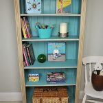 lovely beige shabby chic bookshelves design with blue color accent made of wood with white chair aside