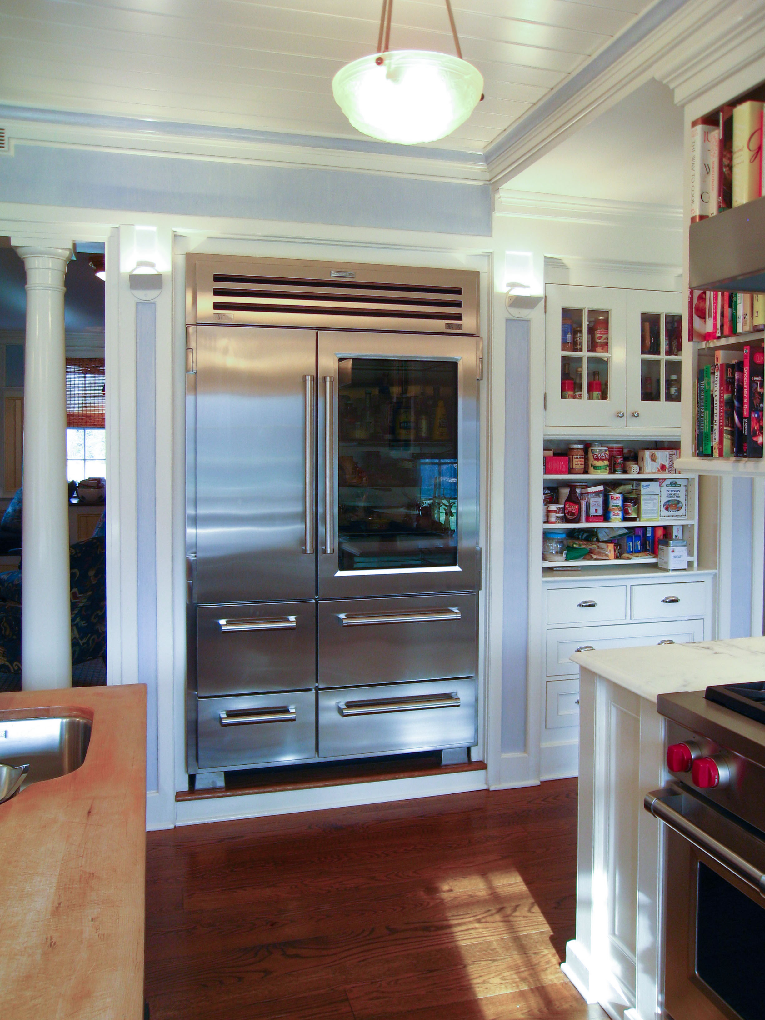 Glass door fridge kitchen - Luxurious And Large Glass Door Residential Refrigerator With Double Door In Kitchen With White Cabinetry And