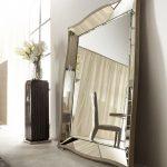 luxurious beveled floor mirror design with mirrored frame beneath white wall aside black vas flower design