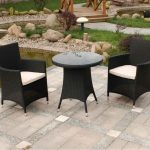 luxurious black walmart patio chair idea with white bolster and round black coffee table on paved patio