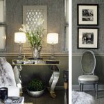 luxurious interior design with metallic grasscloth wallpaper  in gray tone with mirrored console and potted plants and table lamps and seating and wall picture