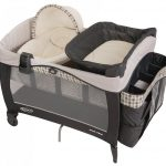 luxurious small pack and play idea in black color with white quilt and canopy and storage and sacks