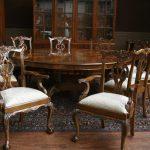 luxurious vintage 84 round dining table design with carved backrest chairs with white bolster and patterned area rug