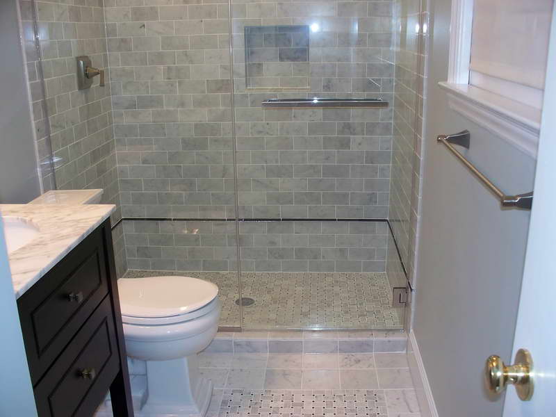 Marble Subway Tile Shower In Modern Bathroom With Glass Door And Wooden  Vanity Units With Marble