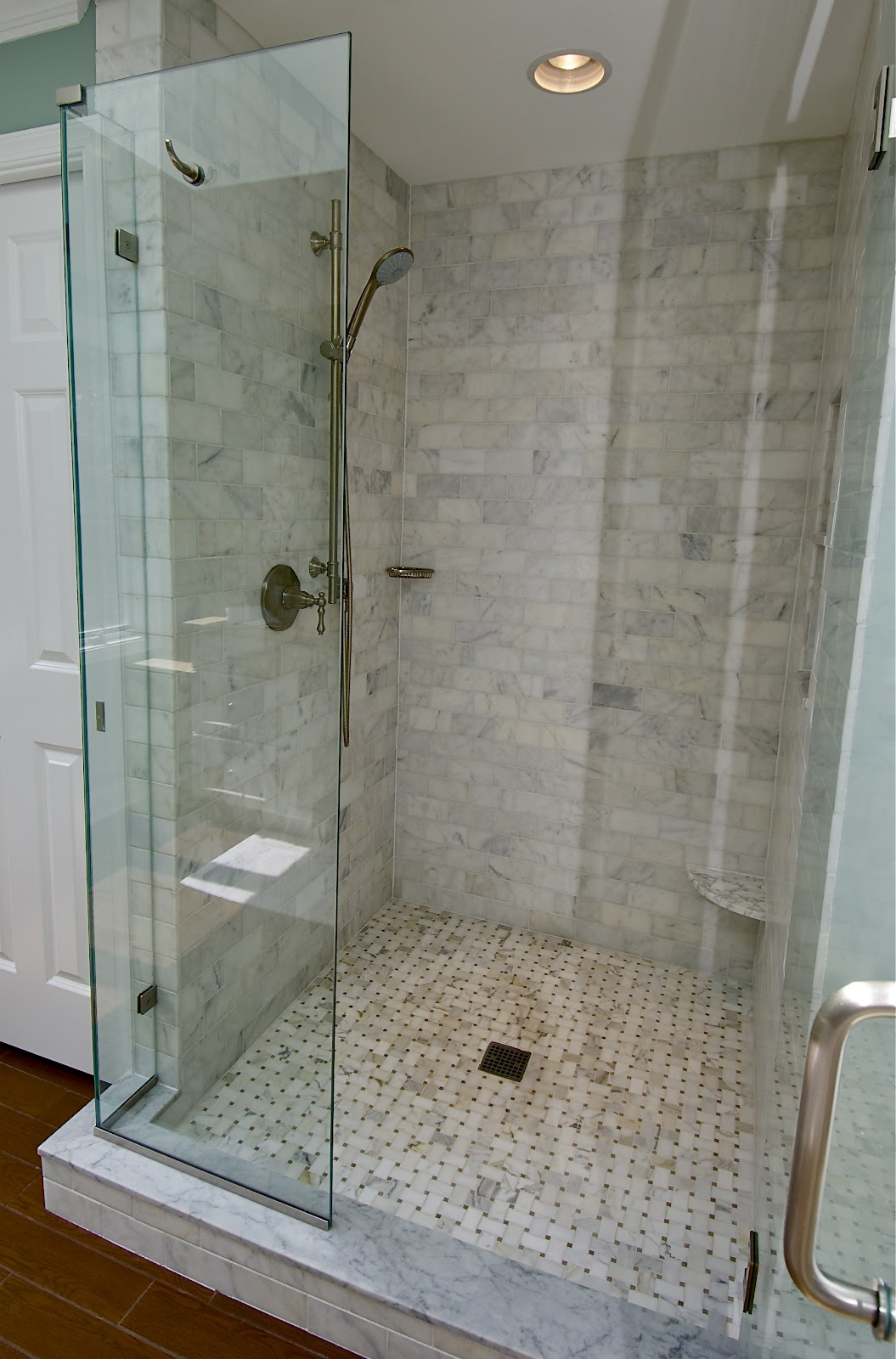 Marble subway tile shower offering the sense of elegance for Bathroom ideas using subway tile