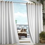 minimalist indoor outdoor curtains in white with wooden chair adorned with striped cushion and greenery