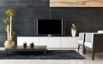 minimalist living room design with ikea white tv stand with short wooden coffee table and white chairs and potted plants