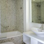 mirror bath tub small toilet sink