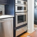modern built in toaster in kitchen cabinet two tones modern kitchen natural woodne floor