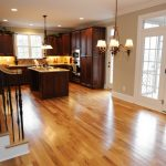 modern engineered hardwood flooring pros and cons installed in contemporary kitchen ideas with solid wooden cabinets and classy ceiling lamps and backsplash
