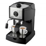 modern hand espresso maker design with two coffe cups and small pump and adjustment knob