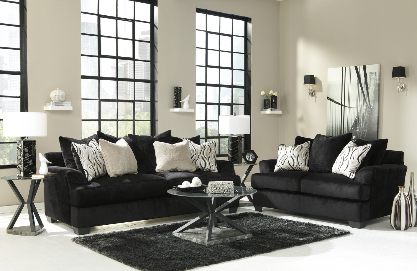 Modern Living Room Design With Black Couch And Loveseat Set In White With  Round Coffee Table