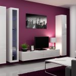 modern living room design with magenta painted wall and ikea white tv stand with tall cabinetry and white sofa and light metal coffee table