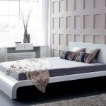 modern platform bed with white heaboard grey wool bedroom carpet modern white table textured white wall system