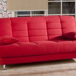 modern red sofa with red pillows