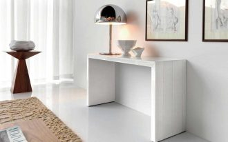 modern slim console table in white decorated with stylish table lamp and pictures on wall decoration plus rug on white flooring