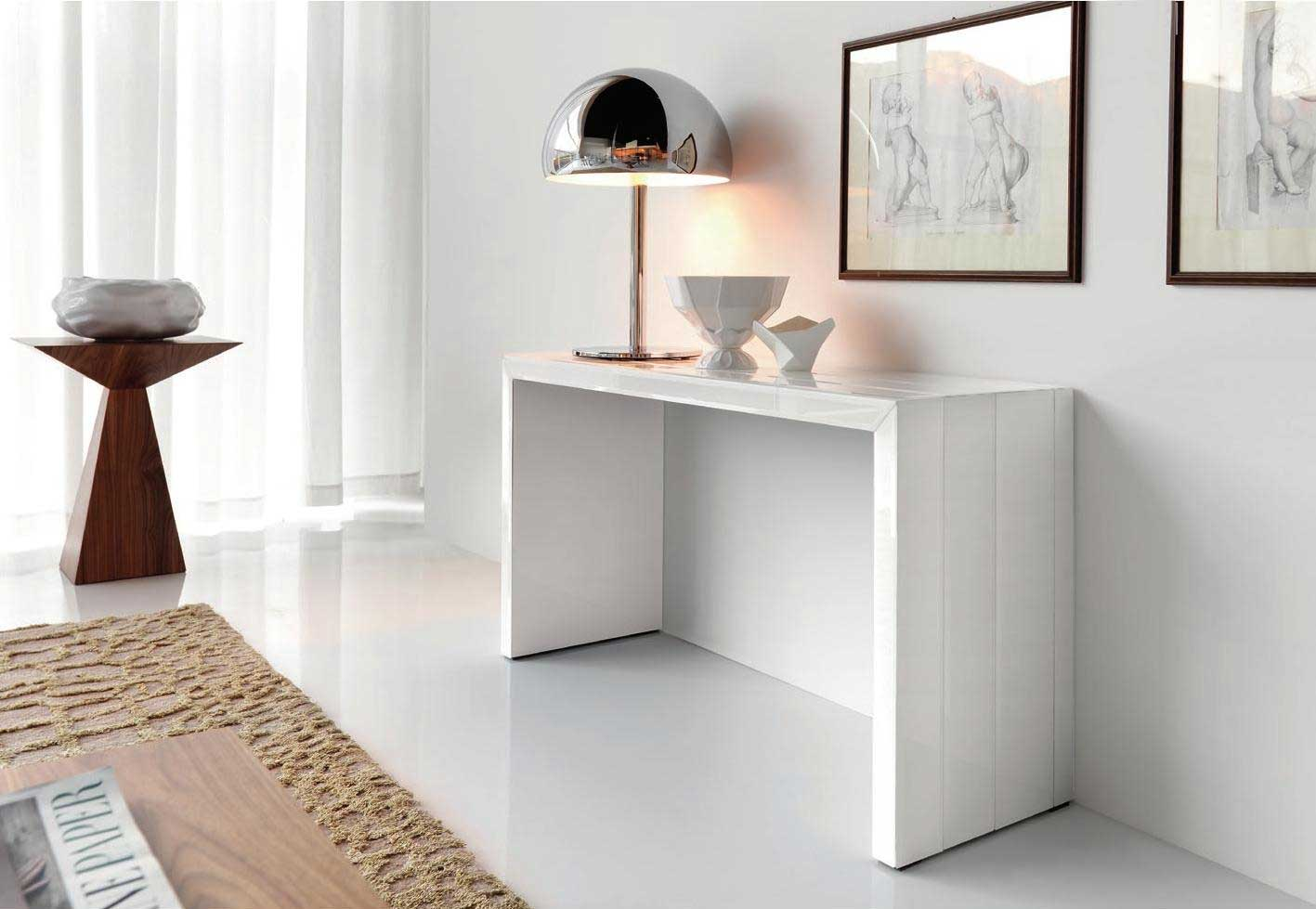 Modern slim console table in white decorated with stylish table lamp and pictures on wall decoration