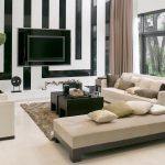 modern sofas in white with neutral tone throw pillows wall mounted flat TV monochromotic wall paint idea modern black coffee table grey wool area rug