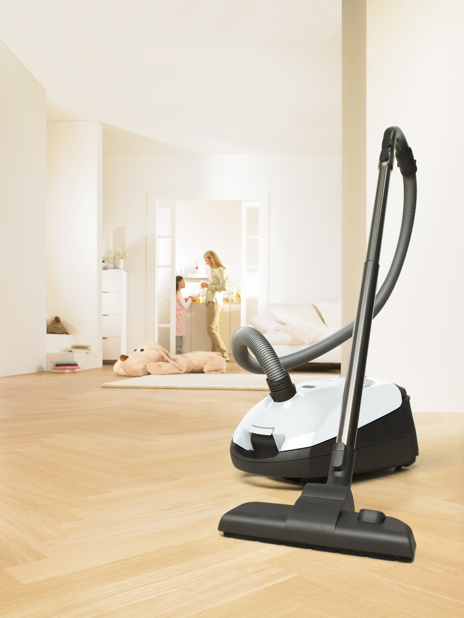 modern-steam-cleaning-for-wood-floor-design-in-black-and-white-combination-on-beige-floor-in-spacious-room.jpg