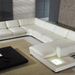 modern white large sectional sofa sleepers soft colr modern living room soft beige fur rug black wooden table