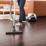 mop for wood floors brown wooden floor living room orange sectional sofa white living room table white rug
