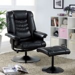 most comfortable recliner in black and modern design combined with black ottoman and soft rug and white bookshelf and pictures frame on wall