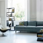 most comfortable sofas in gray and cushions plus unique wooden selving  and comfy reading chair and wooden coffee table