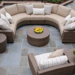 natural beige half round outdoor wicker huge sectional sofa soft color stripped cushions wicker furniture flower pots accent