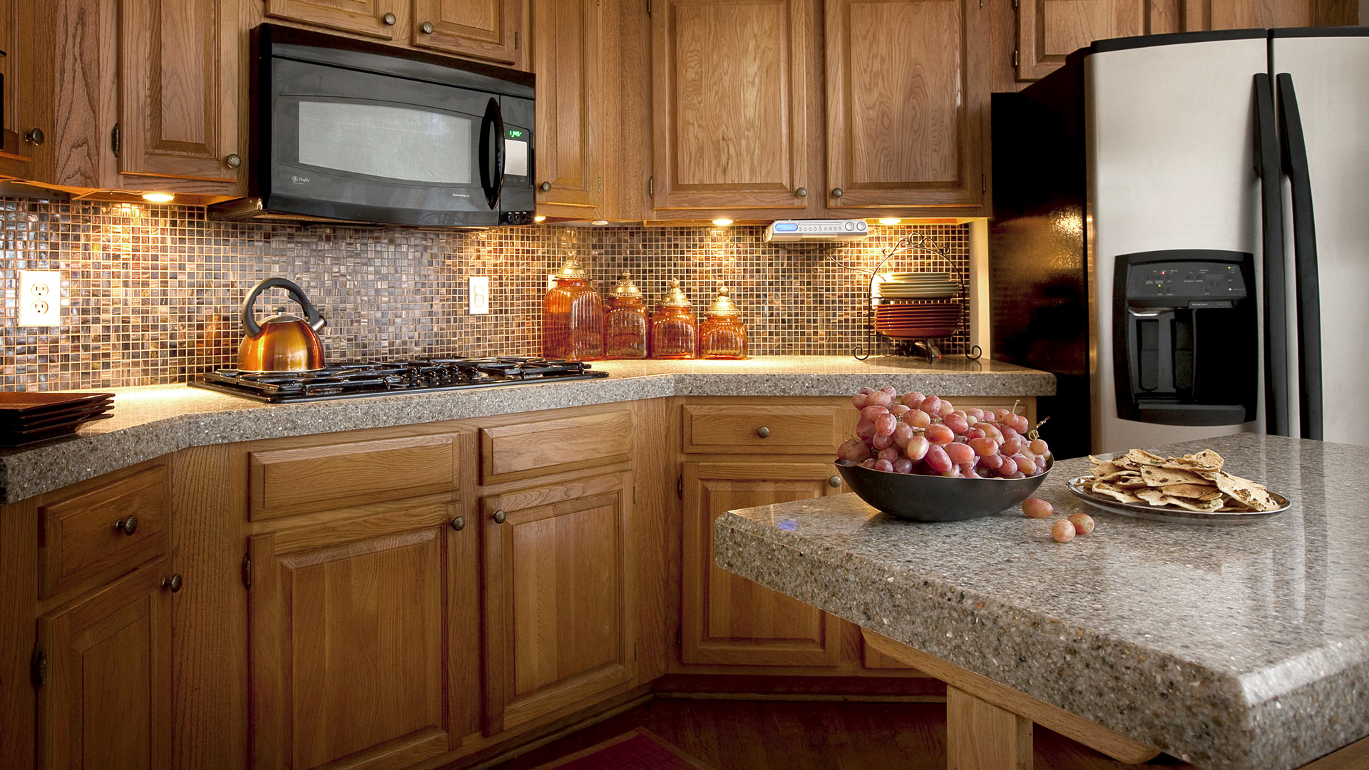 Natural Sand Motive Granite Countertop For Classic Kitchen With Small Tile Blocks Walls And Wooden