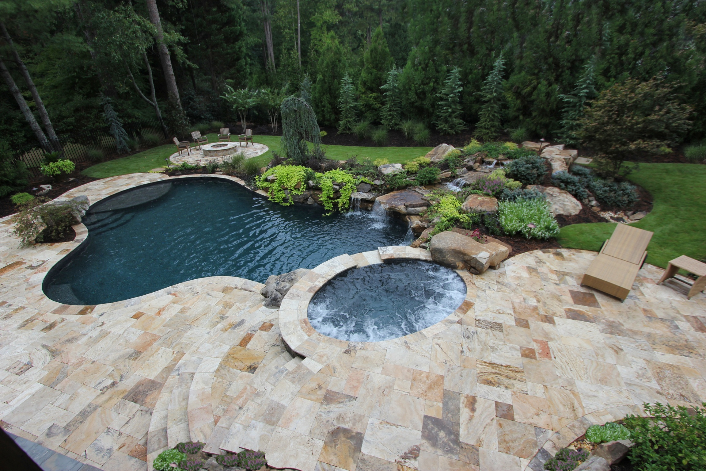 Falling in love with travertine pavers pool deck homesfeed for Natural stone around pool
