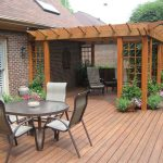 natural wooden backyard patio covers natural wooden chairs beautiful flower in pots wooden floor natural brick color home design