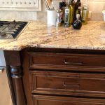 natural wooden cabinet design with cream patterned giallo rio cabinet idea with drawers with modern cooktop