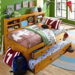 natural wooden captain's bed frame sport motives cushion and bedsheet teenage bedroom colorful round rug sporty decorative wall accents