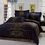 navy golden bedding set high end linens with zebra accent for luxurios bedroom ideas plus wooden nightstand
