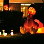 nice bright outdoor thanksgiving decoration idea made of pumpkin on grassy meadow before luxurious house design