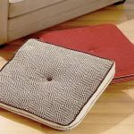 pad shaped ikea floor pillow design in gray and red tone with single tuft pattern on wooden floor