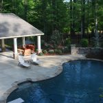 pavilion pool chair plants trees waterfal