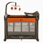 playful single small pack and play idea with brown dominant color and orange accent with storage and toy hanger