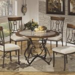 pleasant dining room ideas with wrought iron kitchen table in round shape and glass top plus modern rug and cool wallpaper plus wood flooring