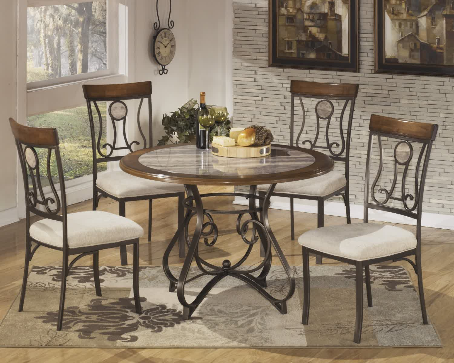 Wrought iron kitchen tables displaying attractive for Round wood dining room table