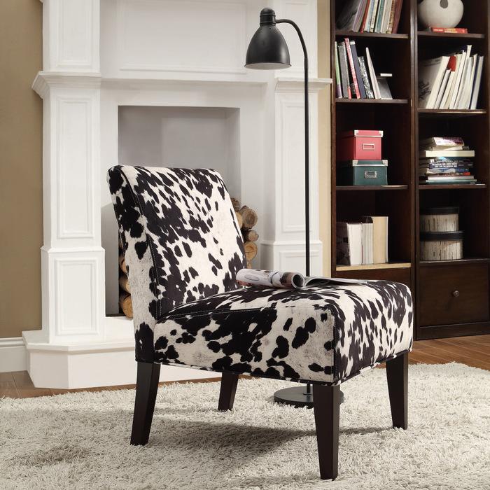 Posh Armless Cow Print Chair Design Beneath Curve Black Floor Lamp On Furry  Rug Aside Wooen
